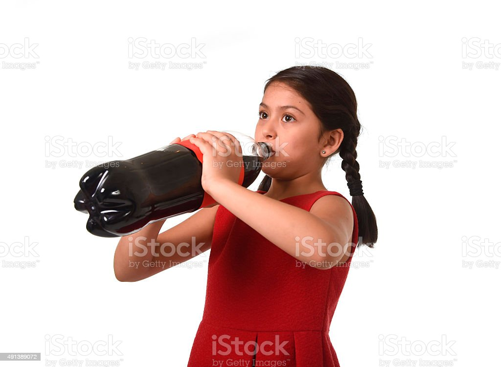 female child holding big soda bottle drinking happy stock photo