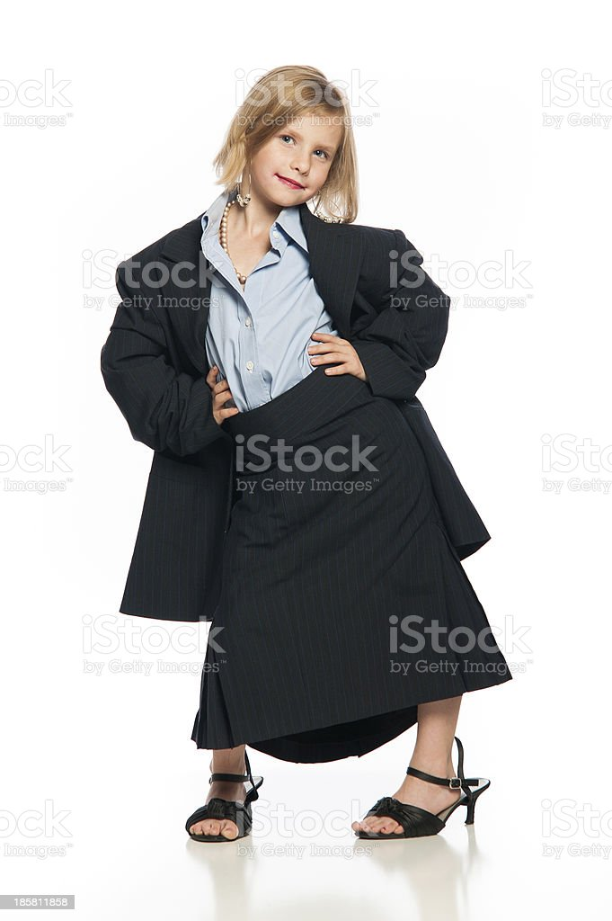 Female Child in Oversized Business Suit With Hands on Hips royalty-free stock photo