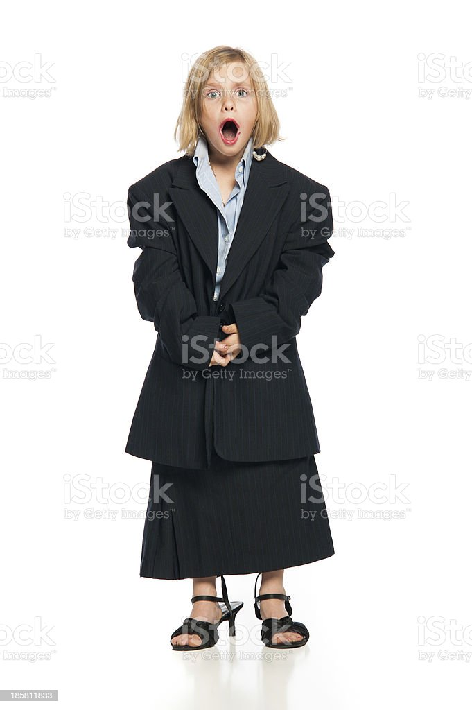 Female Child in Oversized Business Suit With Mouth Open royalty-free stock photo