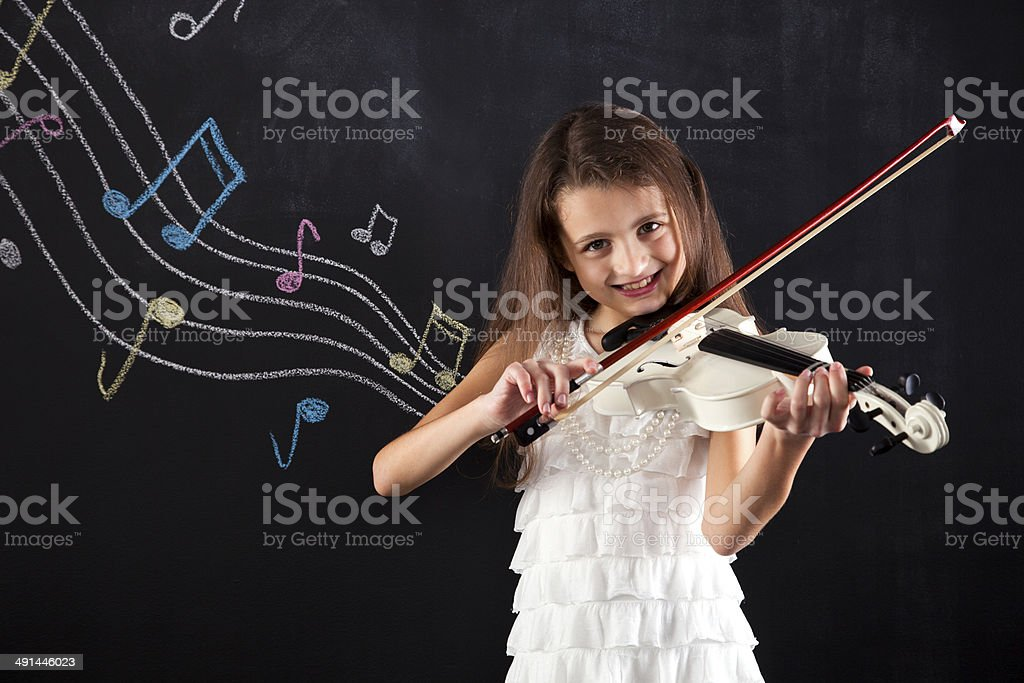 Female child playing the violin stock photo