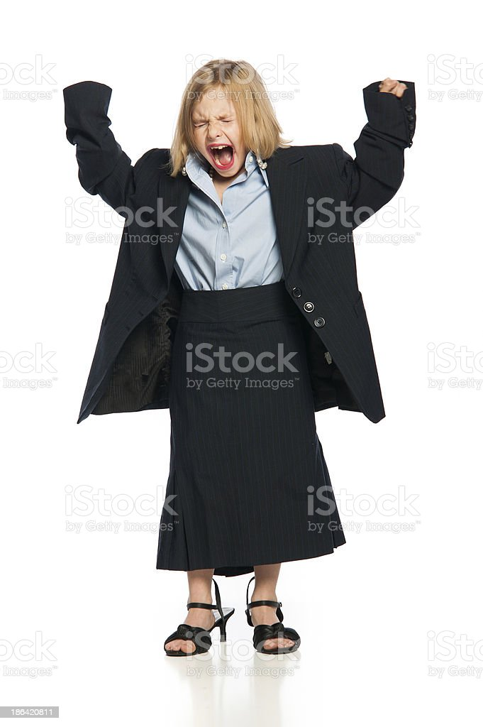 Female Child Screaming in Oversized Business Suit royalty-free stock photo