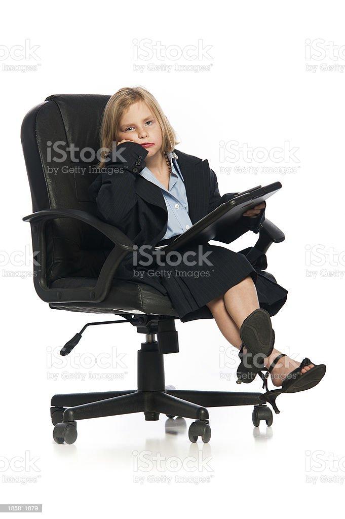 Female Child Sitting Wearing Oversized Business Suit royalty-free stock photo