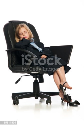 Female Child Wearing Oversized Business Suit Sleeping In Office