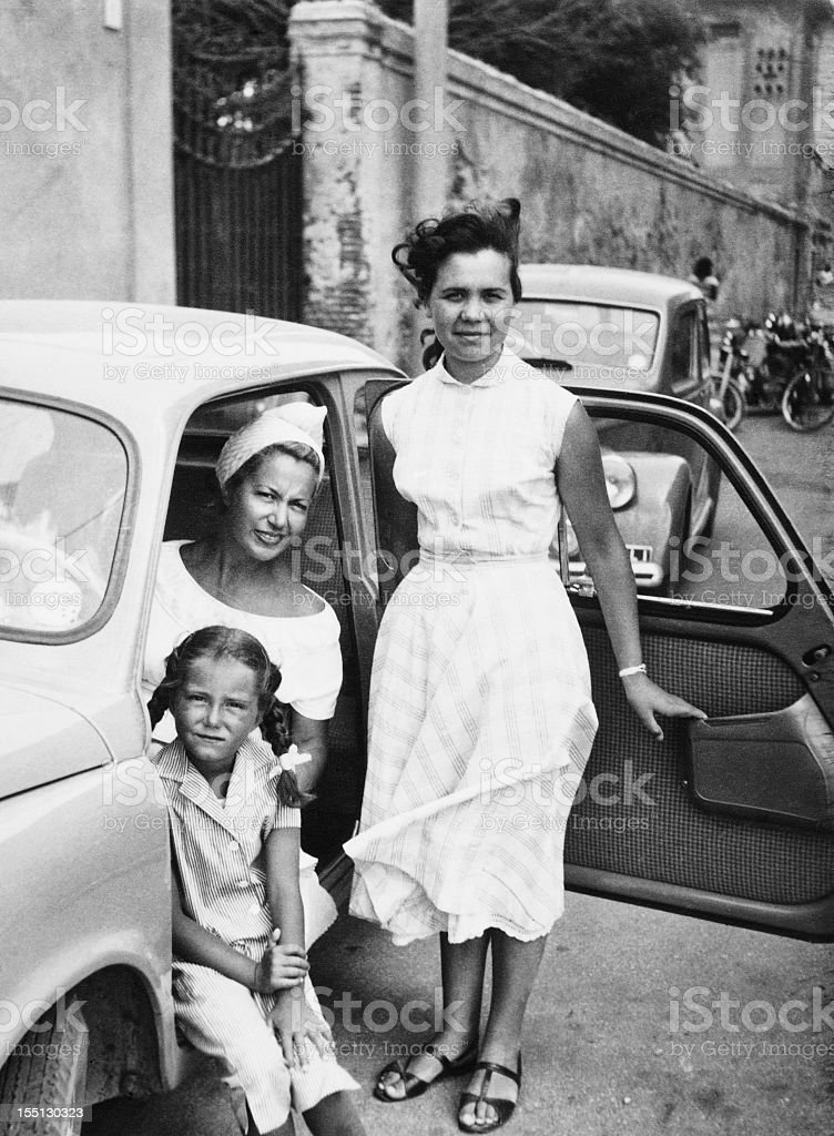 Female Child with Family inside Car,1951. Black And White stock photo