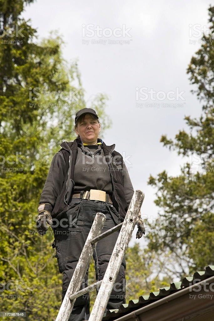 Female chimney sweeper stock photo