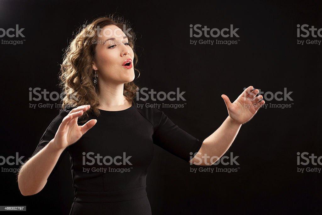 Female choir conductor stock photo