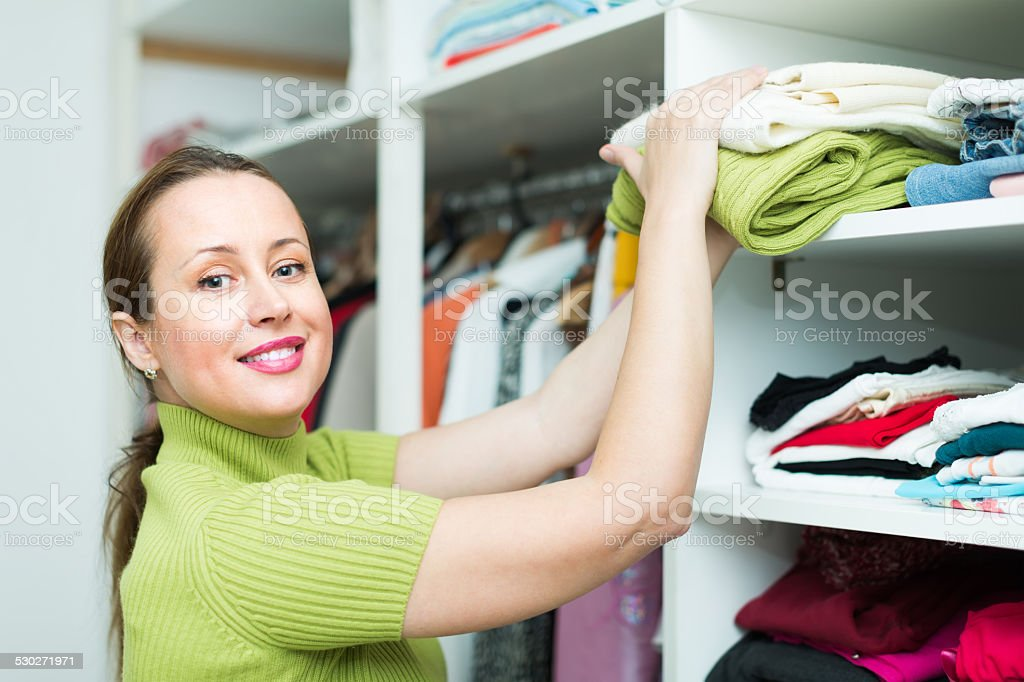 Female choosing apparel at store stock photo