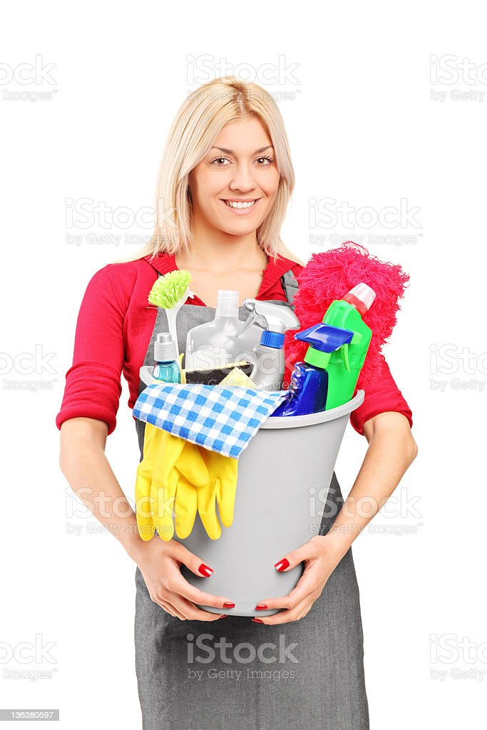 Female cleaner holding a bucket with supplies royalty-free stock photo