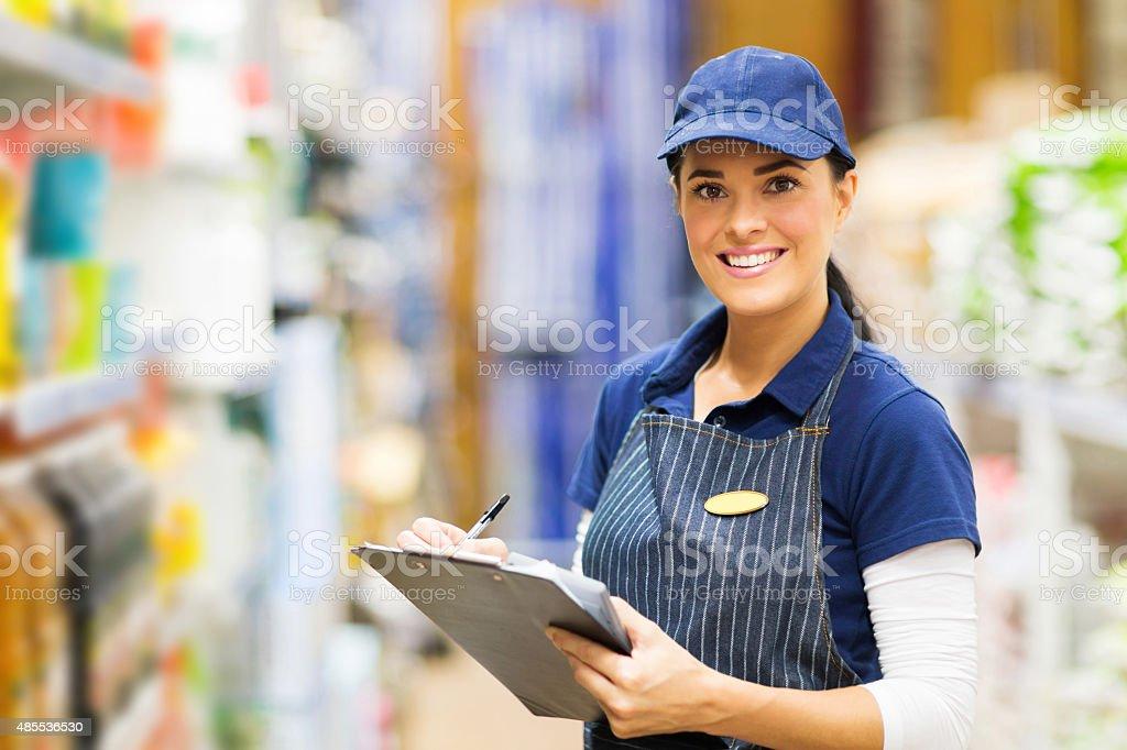 female clerk working in supermarket stock photo