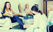Female clients doing toenails