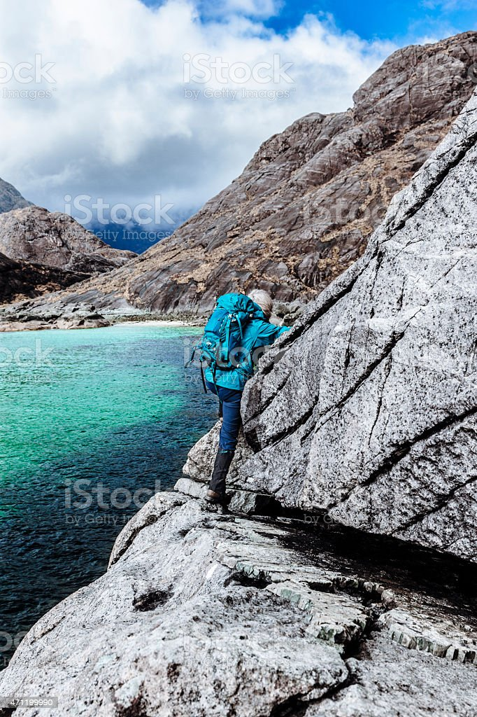 Female climber at the Bad Step on Skye stock photo