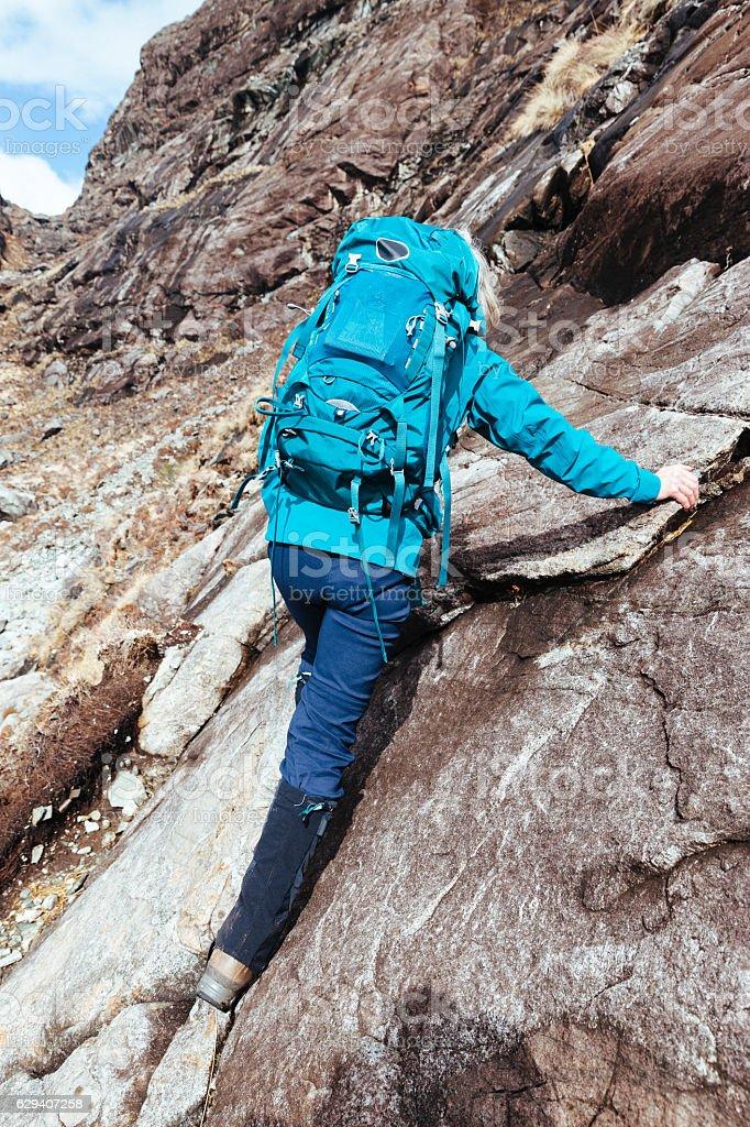 Female climber at the Bad Step on Skye, Scotland stock photo