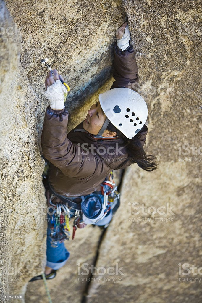 Female climber clinging to a cliff. royalty-free stock photo