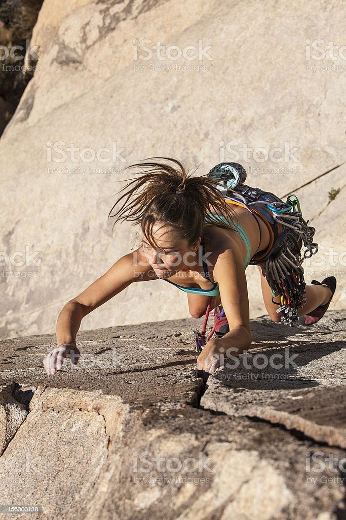 Female climber gripping the rock. royalty-free stock photo