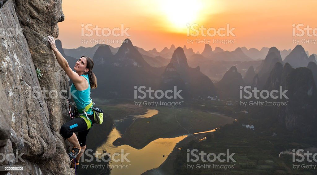 Female climber on Chinese background stock photo