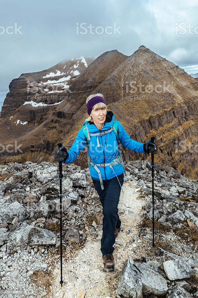 Female climber on Liathach, Torridon, Scotland stock photo