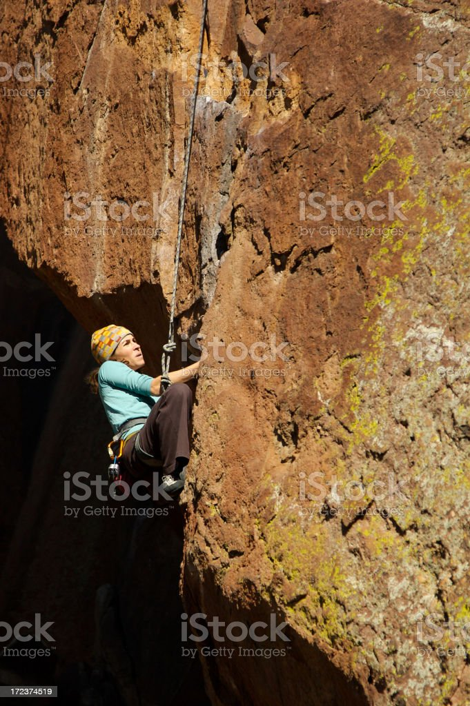 Female climber on wall of rock royalty-free stock photo