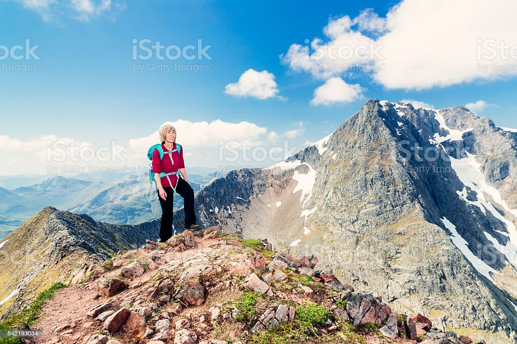 Female climber with Ben Nevis view, Scotland stock photo