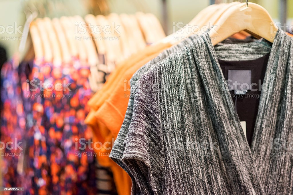 Female clothing hanging in a boutique stock photo