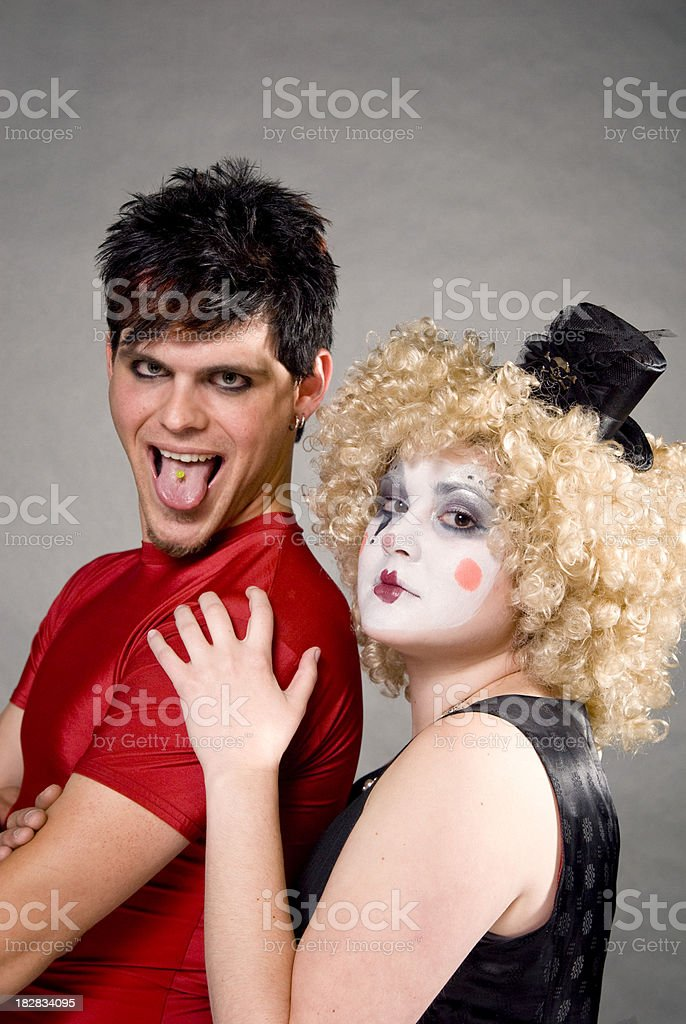 Female Clown & Male Circus Performer with Pierced Tongue Sticking Out stock photo
