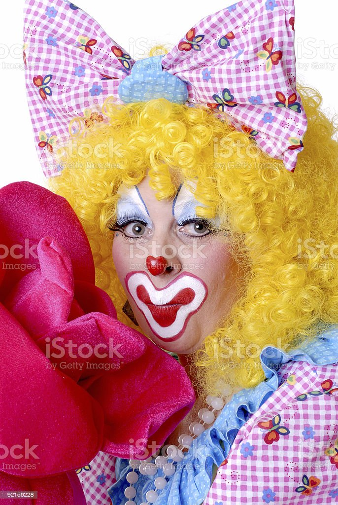 Female Clown With Giant Rose stock photo