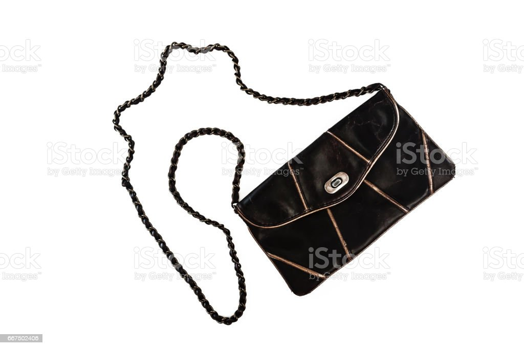 Female clutch bag on a long handle-chain, isolated on a white background stock photo