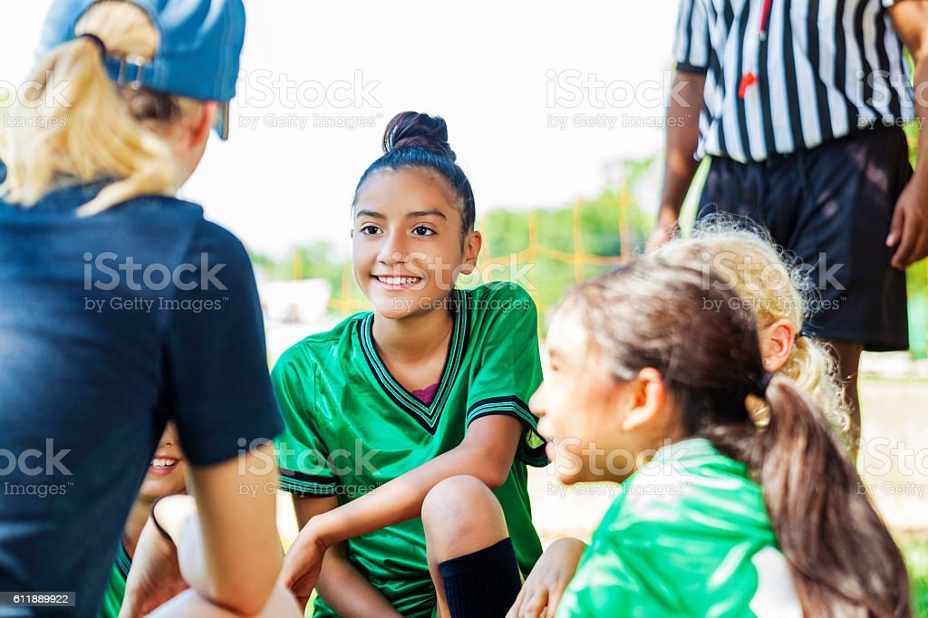 Female coach gives pep talk to her team stock photo