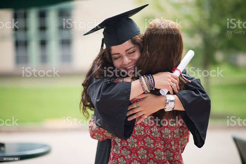 Female college graduate stock photo