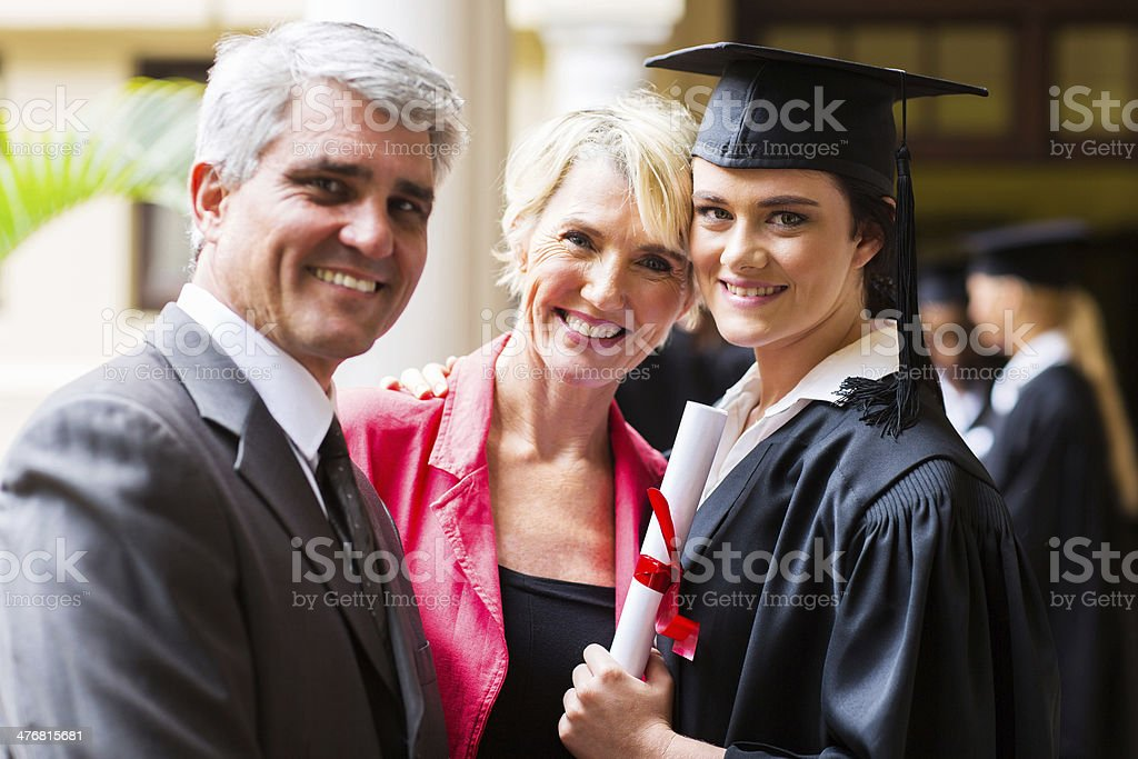 female college graduate with parents stock photo
