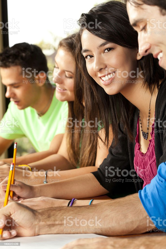 Female College Student Happy While in Class With Students Around royalty-free stock photo