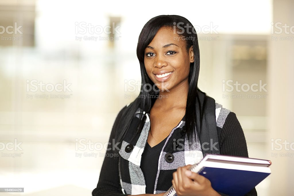 Female college student holding books royalty-free stock photo