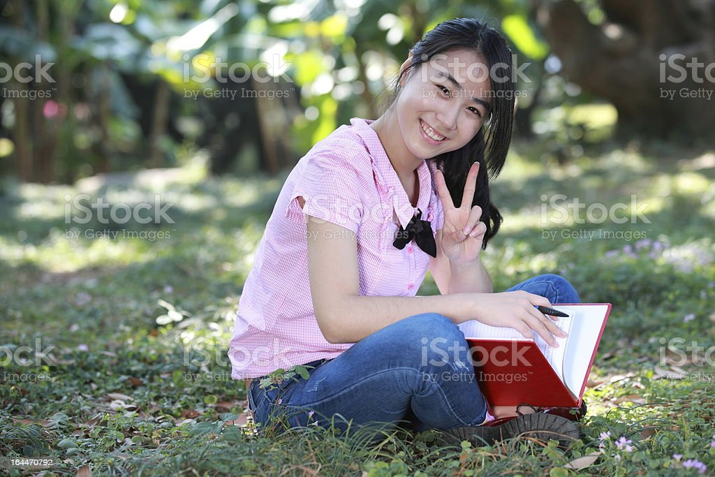 Female college student smiling outdoors learning royalty-free stock photo