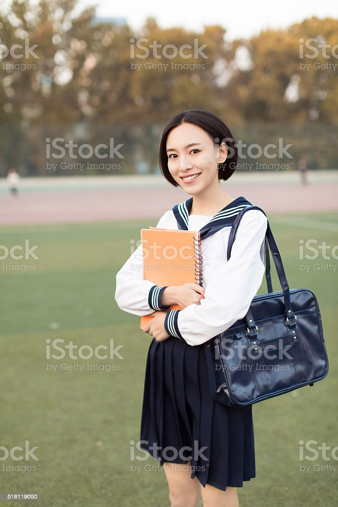 female college students at the stadium stock photo