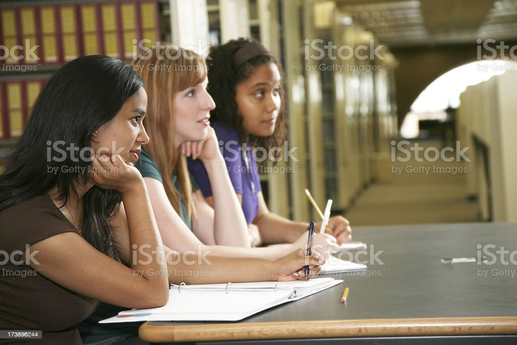 Female College Students Concentrating on Taking Notes royalty-free stock photo