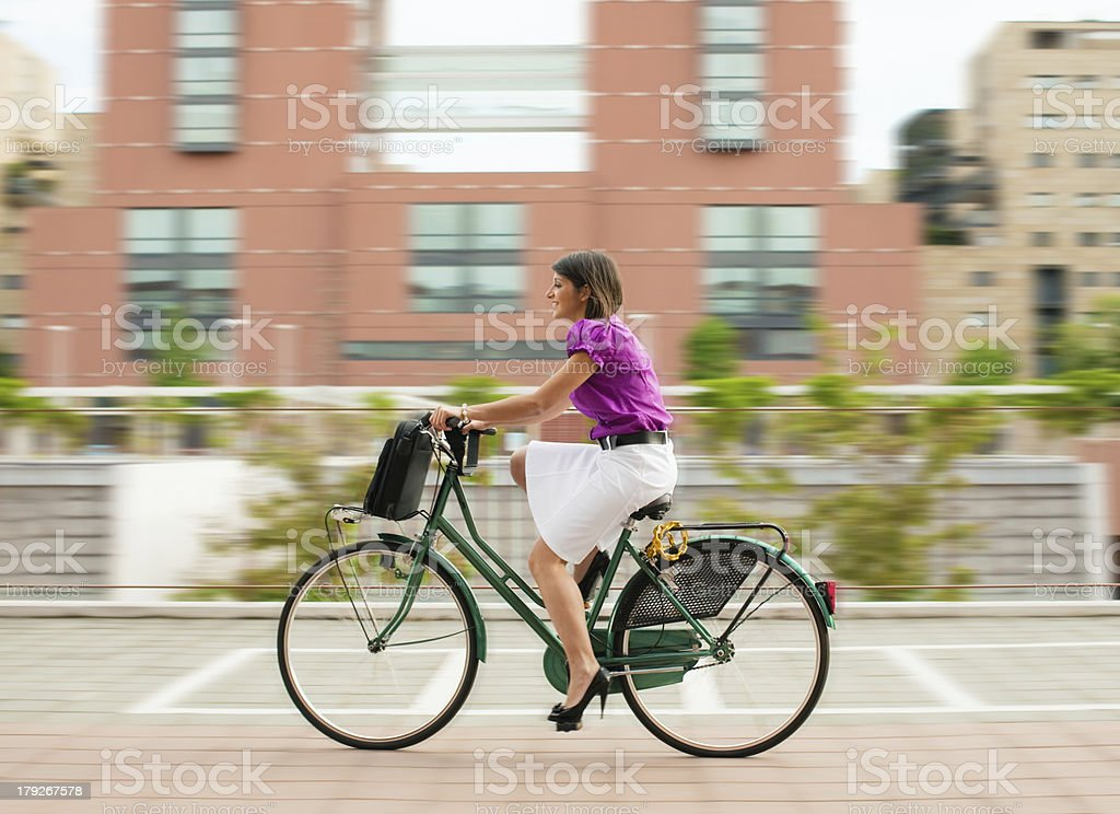 female commuter cycling royalty-free stock photo