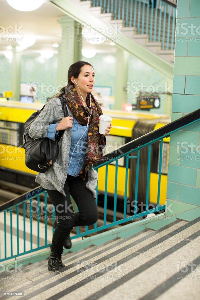 Female commuter exiting subway station stock photo