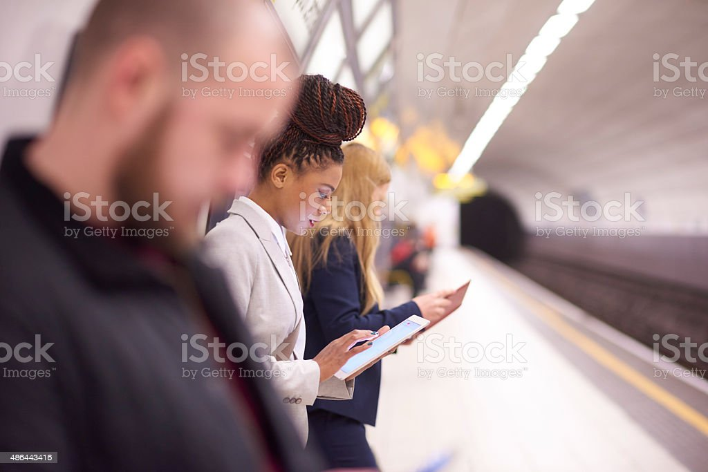 female commuter in the subway stock photo