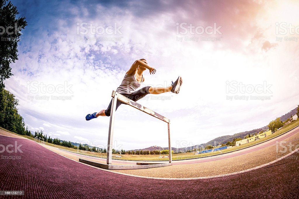Female competitor jumping the steeplechase obstacle royalty-free stock photo