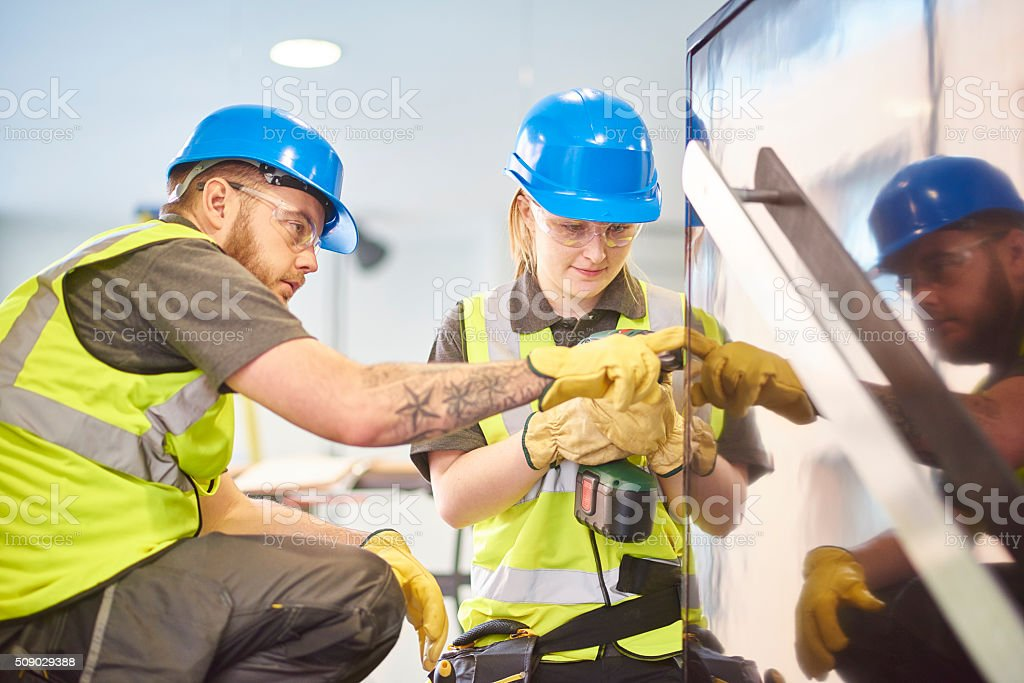 female construction apprentice and colleague stock photo