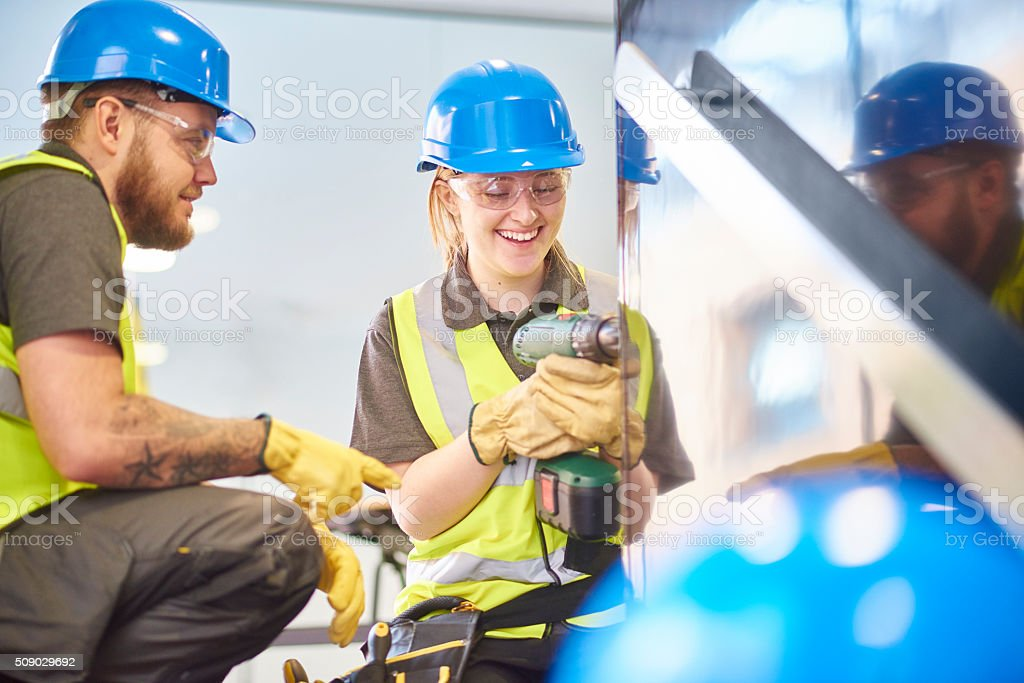 female construction apprentice and colleague stock photo