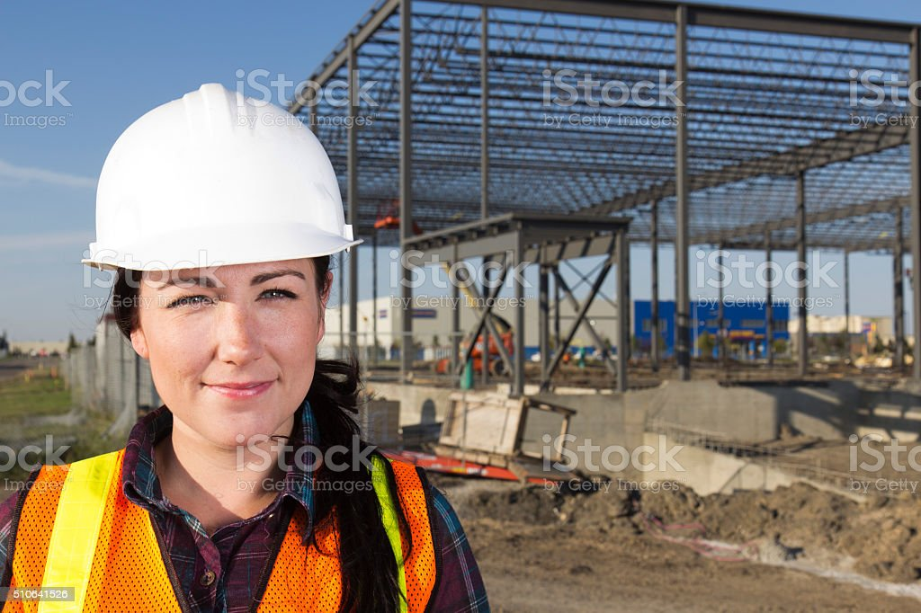 Female Construction Engineer and Steel Frame Building Site stock photo