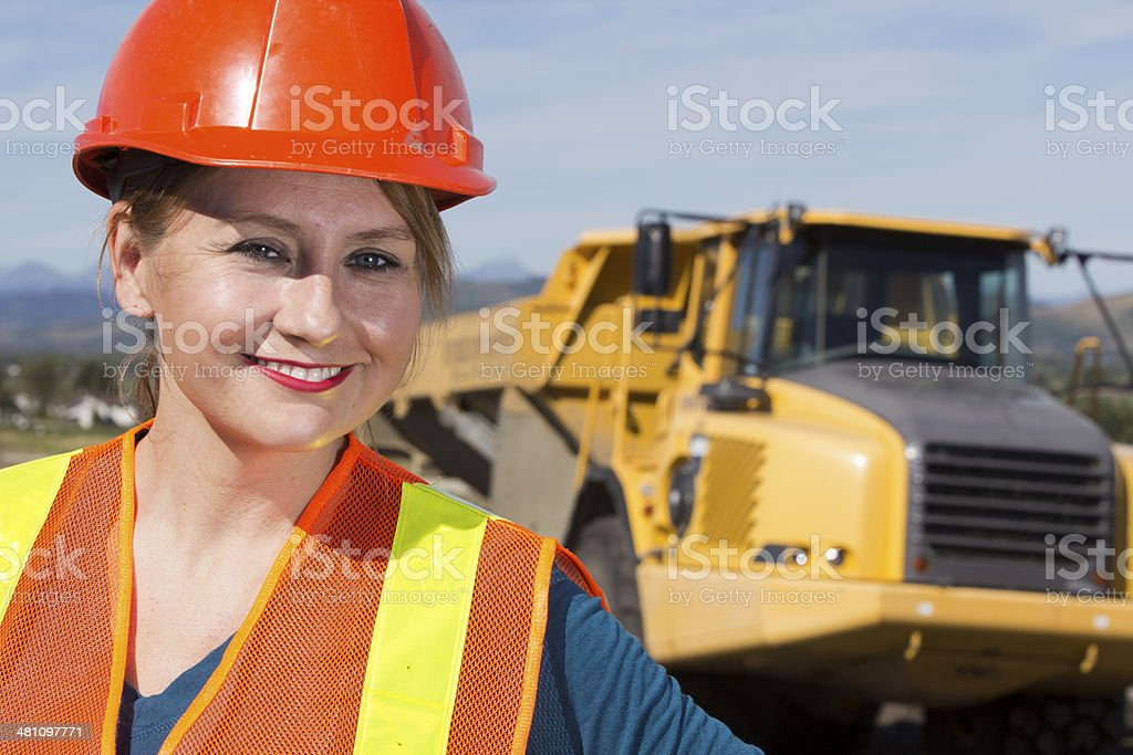 Female Construction Worker and Dump Truck stock photo