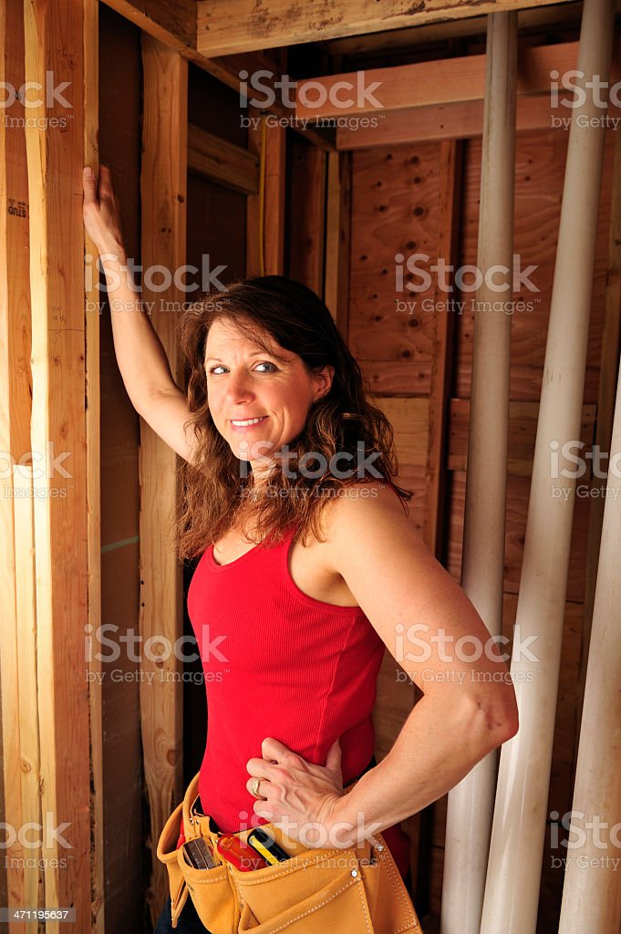 Female construction worker assessing building site. royalty-free stock photo
