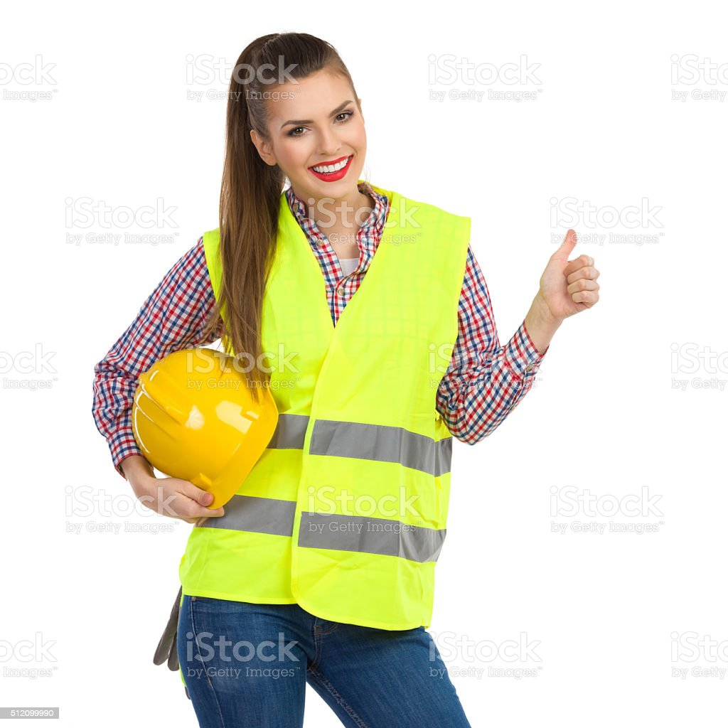 Female Construction Worker Giving Thumb Up stock photo