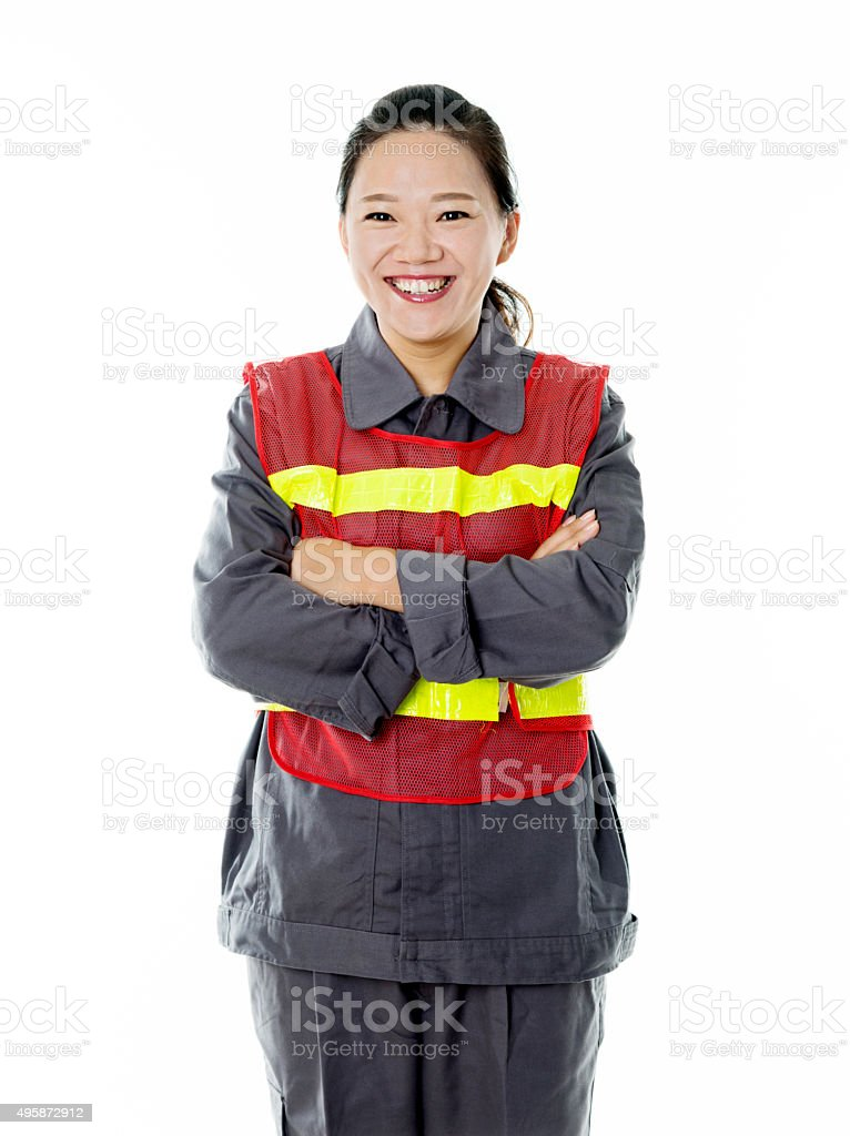 Female construction worker in a reflective vest stock photo