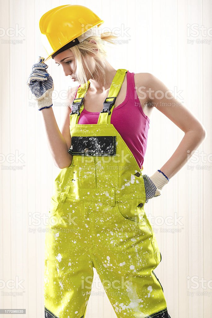 Female construction worker posing indoors royalty-free stock photo