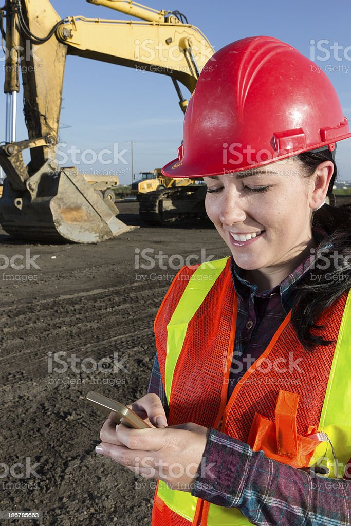 Female Construction Worker Texting royalty-free stock photo