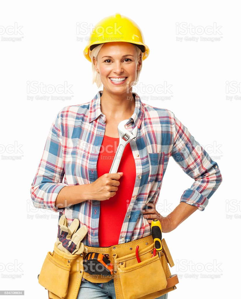 Female Construction Worker With Hand On Hip Holding Wrench stock photo