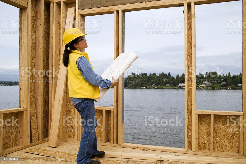 Female Construction Worker with Plans royalty-free stock photo