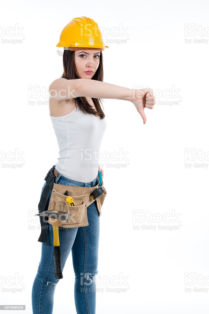 Female construction worker with thumb down stock photo